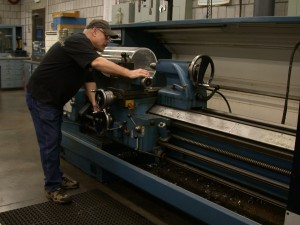 Here is our director, Barry Evans, doing some big lathe work. We can do large lathe work up to a diameter of 3ft and 12ft in length.